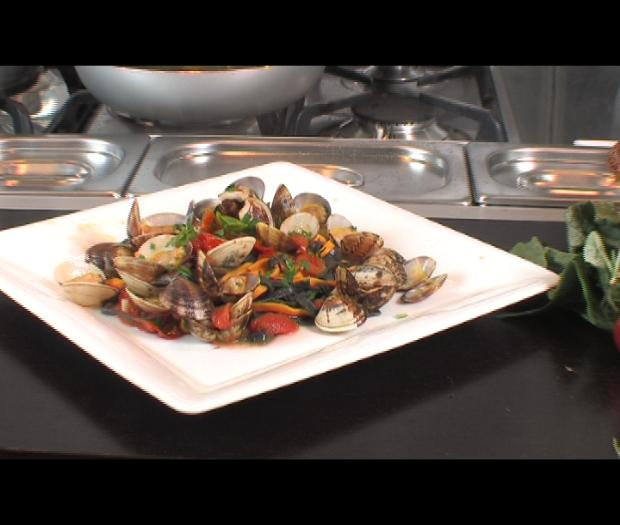 Red and black tagliatelle with clams and cherry tomatoes