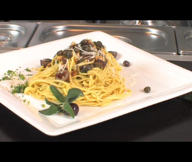 Spaghetti Chitarra with olives, capers, hazelnuts, anchovies