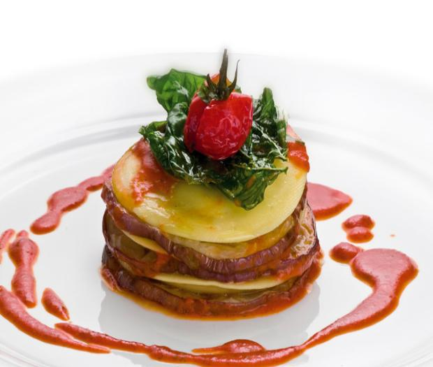 Panciotti with Bufala cheese and eggplants served on cherry tomatoe sauce
