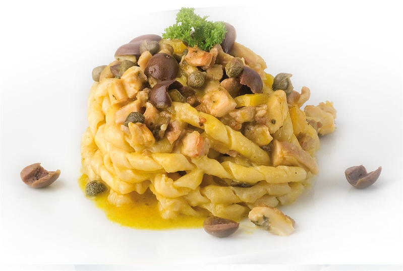 Fusilli pasta with peppers, rabbit, olives and capers