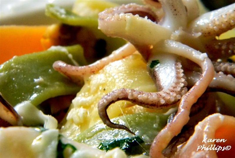 Calamarata 4 stagione with baby squid, clams and mozzarella di bufala dop