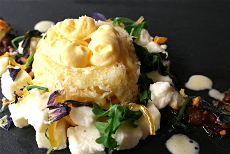 Nidi of sweet dough, white chocolate mousse and oil, buffalo mozzarella, caramelized walnuts, candied lemon and flowers