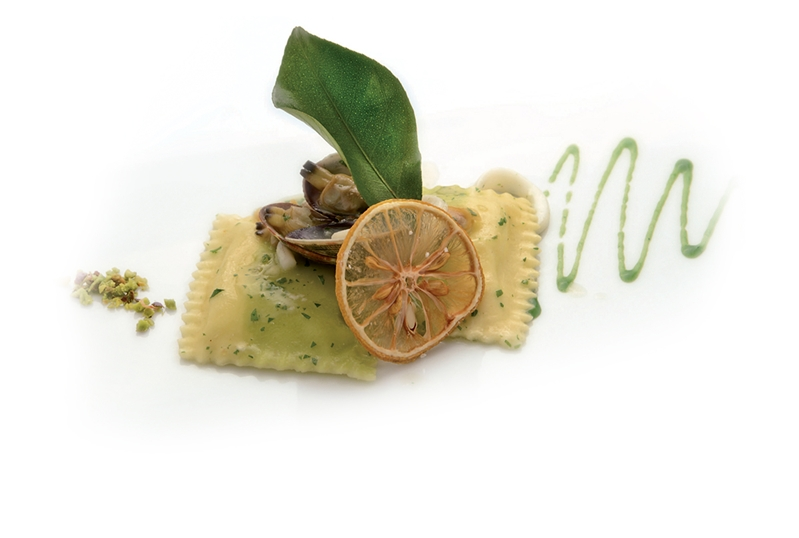 Squared stuffed Lemon Pasta with clams, squid, pistachios and parsley emulsion