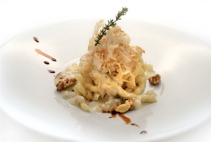 Fusilli Pasta with cod, crispy onion and walnuts
