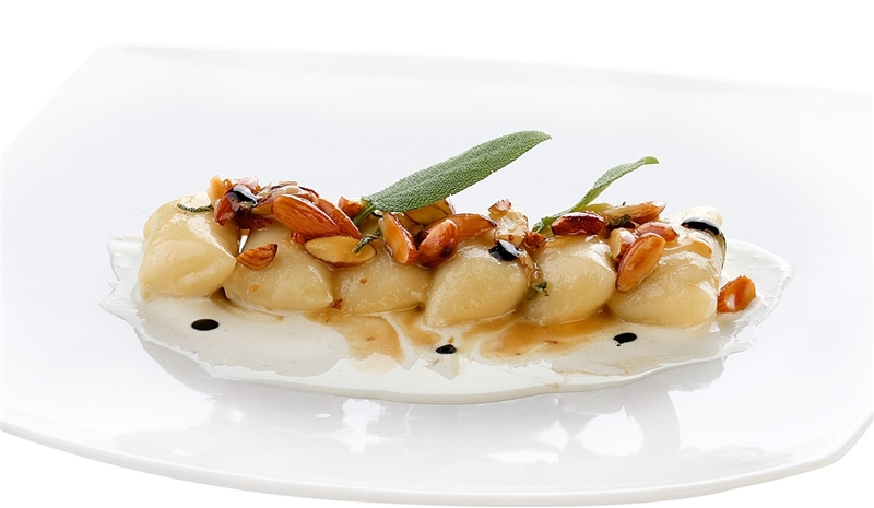 Gnocchi filled with mozzarella, almonds and chestnut honey served on a Gorgonzola fondue