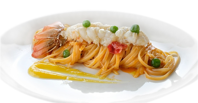 "Lobster Linguini with Piennolo Tomatoes on a cream of ""Corbara"" yellow cherry tomatoes."
