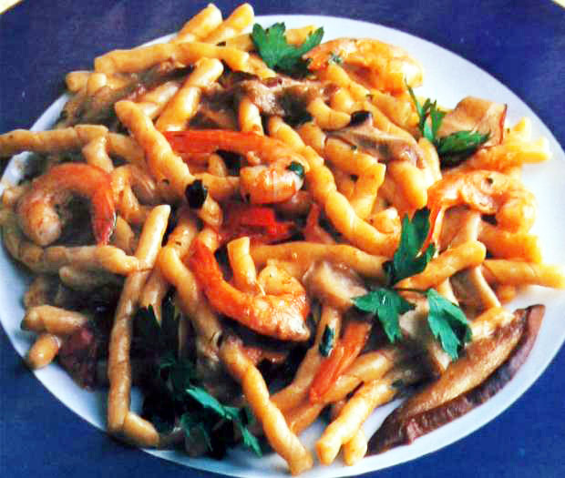 Fusilli with porcini mushrooms and red prawns