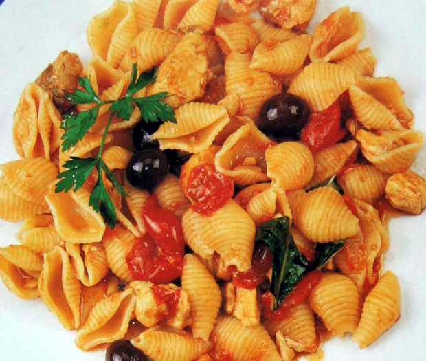 Conchiglie pasta with swordfish and black olives